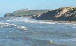 La mer rognant les dunes.